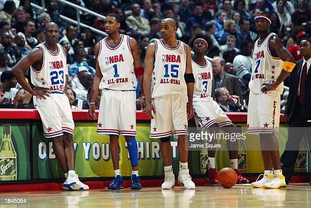Michael Jordan Tracy McGrady Vince Carter Ben Wallace and Jermaine O'Neal of the Eastern Conference AllStars look on at the 2003 NBA AllStar Game on...