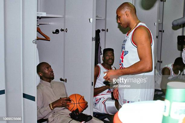 Michael Jordan and Charles Barkley of the Eastern Conference AllStars chats in the locker room against the Western Conference AllStars during the...