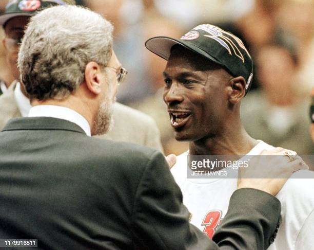 Michael Jordan and Chicago Bulls head coach Phil Jackson congratulate each other 14 June after winning game six of the NBA Finals against the Utah...