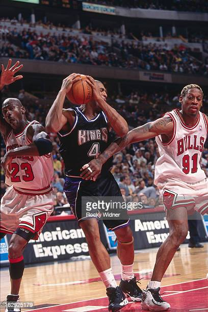 Michael Jordan and Dennis Rodman of the Chicago Bulls battle for position against Corliss Williamson of the Sacramento Kings against the Sacramento...