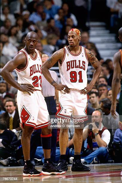 Michael Jordan and Dennis Rodman of the Chicago Bulls catch their breath during Game Two of the 1996 NBA Finals against the Seattle SuperSonics at...