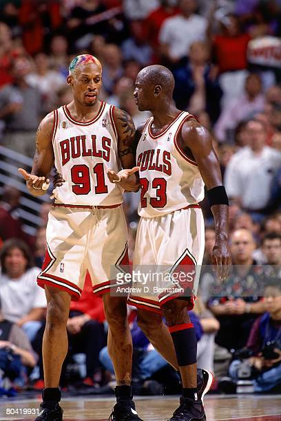 Michael Jordan and Dennis Rodman of the Chicago Bulls discuss strategy in Game Six of the 1996 NBA Finals against the Seattle SuperSonics at the...