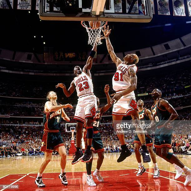Michael Jordan and Dennis Rodman of the Chicago Bulls elevate for a rebound in Game Six of the 1996 NBA Finals against the Seattle SuperSonics at the...