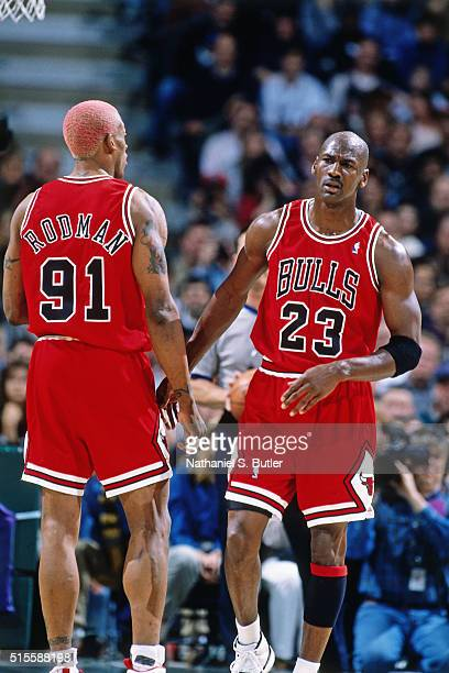 Michael Jordan and Dennis Rodman of the Chicago Bulls talk against the Milwaukee Bucks on April 16 1996 at the Bradley Center in Milwaukee Wisconsin...