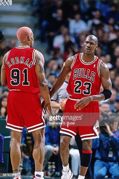 Michael Jordan and Dennis Rodman of the Chicago Bulls talk against the Milwaukee Bucks on April 16 1996 at the Bradley Center in Milwaukee Wisconsin...