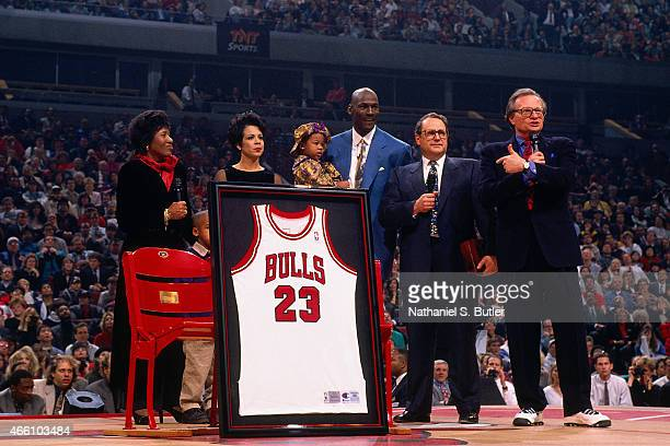 Michael Jordan and his family pose for a photo during Michael Jordan's jersey retirement on November 1 1994 at the United Center in Chicago Illinois...