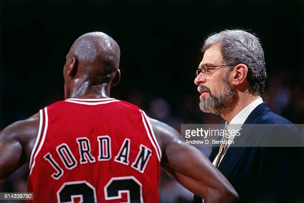 Michael Jordan and Phil Jackson of the Chicago Bulls look on against the Miami Heat on April 2 1996 at Miami Arena in Miami Florida NOTE TO USER User...