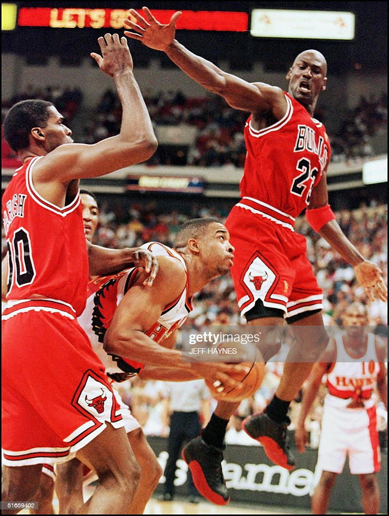 Michael Jordan and Robert Parish of the Chicago Bulls try to block... News Photo   Getty Images
