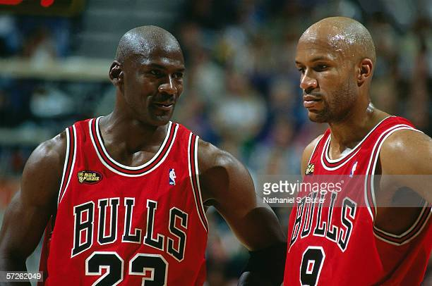 Michael Jordan and Ron Harper of the Chicago Bulls look on during game six of the 1998 NBA Finals against the Utah Jazz on June 14 1998 in Salt Lake...