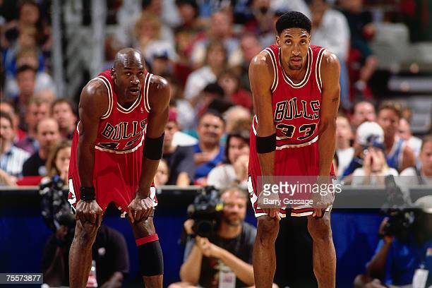Michael Jordan and Scottie Pippen of the Chicago Bulls catch their breath against the Orlando Magic in Game One of the 1995 Easter Conference...