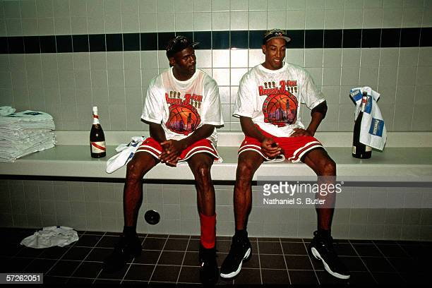Michael Jordan and Scottie Pippen of the Chicago Bulls celebrate in the locker room after winning the 1998 NBA Championship against the Utah Jazz on...