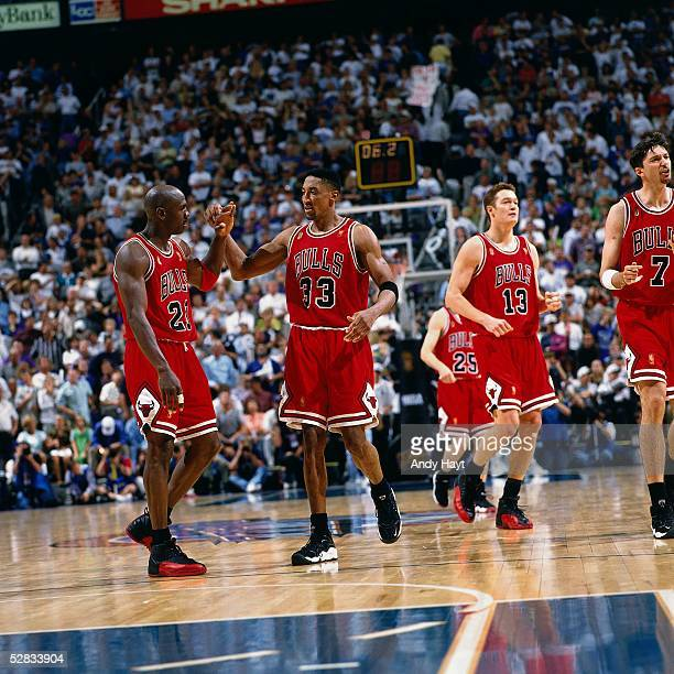 Michael Jordan and Scottie Pippen of the Chicago Bulls celebrate during game five of the 1997 NBA Finals against the Utah Jazz at the Delta Center on...