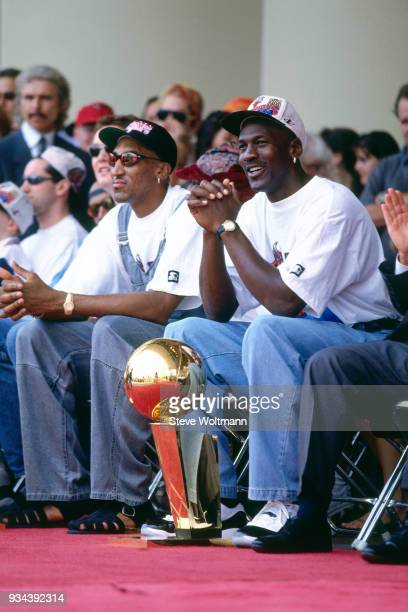 Michael Jordan and Scottie Pippen of the Chicago Bulls celebrates at the Bulls 1996 NBA Championship parade on June 18 1996 in Chicago Illinois NOTE...