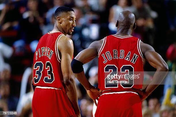 Michael Jordan and Scottie Pippen of the Chicago Bulls discuss strategy against the Seattle SuperSonics in Game Five of the 1996 NBA Finals at Key...