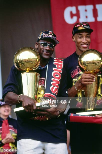 Michael Jordan and Scottie Pippen of the Chicago Bulls hold the Championship Trophy at the Chicago Bulls Championship Parade and Rally on June 16...