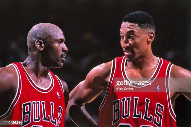 Michael Jordan and Scottie Pippen of the Chicago Bulls huddle together against the Charlotte Hornets on May 8 1998 at Charlotte Coliseum in Charlotte...