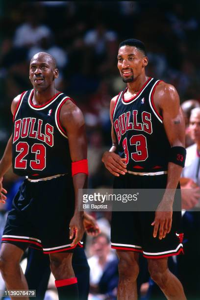 Michael Jordan and Scottie Pippen of the Chicago Bulls look on during the game against the Houston Rockets on April 5 1998 at The Summit in Houston...