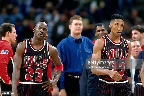 Michael Jordan and Scottie Pippen of the Chicago Bulls take the court against against the Milwaukee Bucks at the Bradley Center on June 10 1997 in...