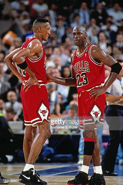 Michael Jordan and Scottie Pippen of the Chicago Bulls talk against the Cleveland Cavaliers circa 1991 at the Richfield Coliseum in Richfield Ohio...