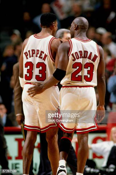Michael Jordan and Scottie Pippen of the Chicago Bulls talk things over during an NBA game against the Portland Trailblazers at Chicago Stadium on...