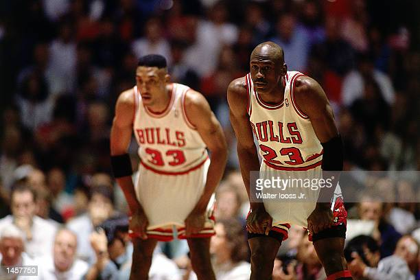 Michael Jordan and Scottie Pippen of the Chicago Bulls wait for the action to start in 1993 during an NBA game at The Chicago Stadium in Chicago...