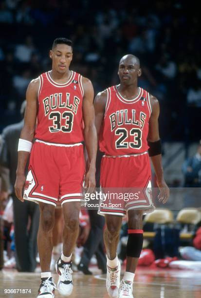 Michael Jordan and Scottie Pippen of the Chicago Bulls walks up court against the Washington Bullets during an NBA basketball game circa 1992 at the...