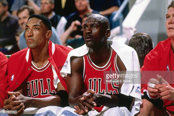 Michael Jordan and Scottie Pippen of the Chicago Bulls watch play from the bench during game three of the semifinals of the 1998 NBA Playoffs against...
