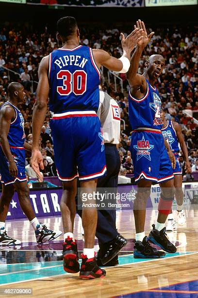 Michael Jordan and Scottie Pippen of the Eastern Conference AllStars high fives against the Western Conference AllStars during the 1993 AllStar Game...