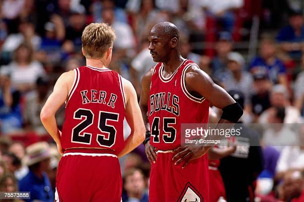 Michael Jordan and Steve Kerr of the Chicago Bulls discuss strategy against the Orlando Magic in Game One of the 1995 Easter Conference SemiFinals at...