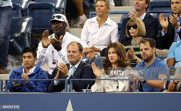 Michael Jordan, Anna Wintour, below them Tony Godsick and Mirka Federer attend Roger Federer's match on Day 2 of the 2014 US Open at USTA Billie Jean...