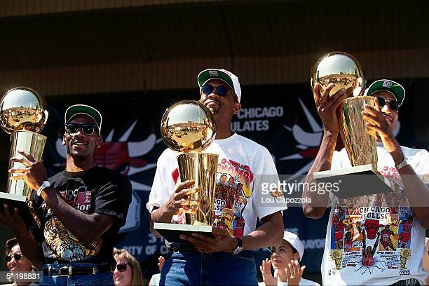 Michael Jordan Bill Cartwright and Scottie Pippen of the Chicago Bulls celebrates during a rally after the Bulls defeated the Phoenix Suns in six...