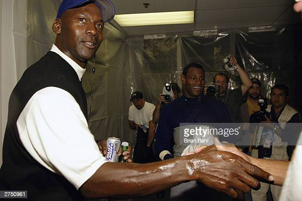 Michael Jordan celebrates with Sammy Sosa and the Chicago Cubs in the locker room after the Chicago Cubs victory over the Atlanta Braves in Game 5 of...