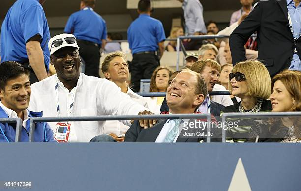Michael Jordan chats with Tony Godsick and Anna Wintour during Roger Federer's match on Day 2 of the 2014 US Open at USTA Billie Jean King National...