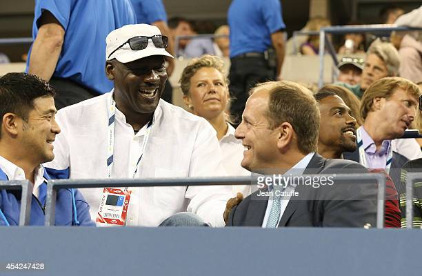 Michael Jordan chats with Tony Godsick during Roger Federer's match on Day 2 of the 2014 US Open at USTA Billie Jean King National Tennis Center on...