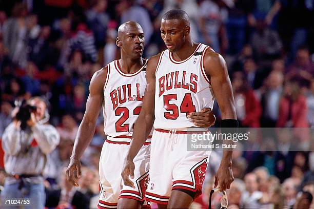 Michael Jordan comforts teammate Horace Grant of the Chicago Bulls during Game One of the Eastern Conference Finals against the Cleveland Cavaliers...