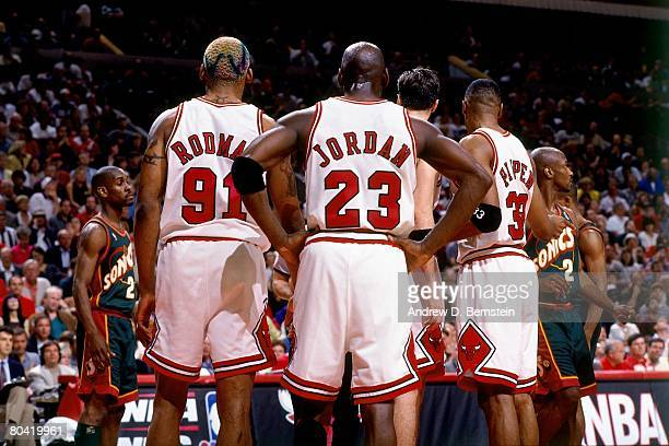 Michael Jordan Dennis Rodman and Scottie Pippen of the Chicago Bulls discuss strategy in Game Six of the 1996 NBA Finals against the Seattle...