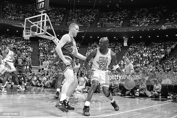 Michael Jordan dribbles the ball against Chris Mullin during the 1992 NBA AllStar Game at Orlando Arena on February 9 1992 in Orlando Florida NOTE TO...