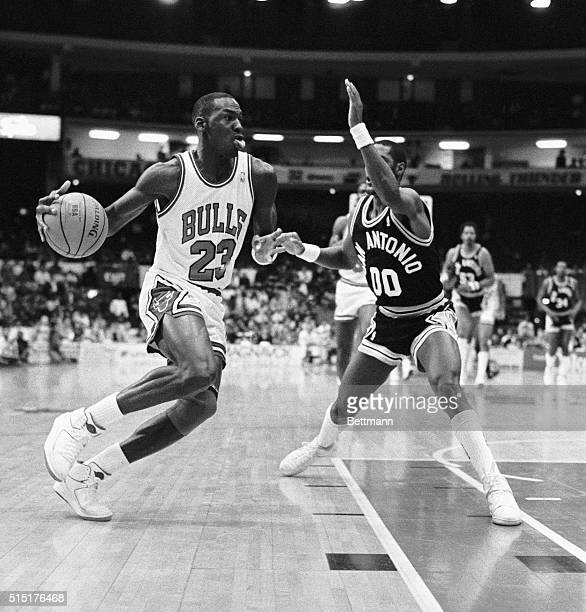 Michael Jordan drives around Spurs' Johnny Moore to the basket during first quarter action 11/4 in Chicago Bulls won 111104 leaving them undefeated 30