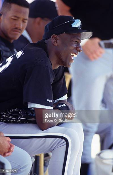 Michael Jordan enjoys a laugh at the dugout during spring training with the White Sox