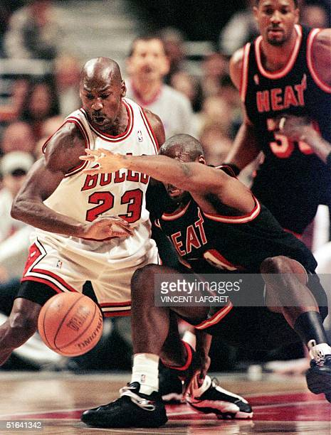 35993466f9d Michael Jordan guard for the Chicago Bulls steals the ball from Voshon  Lenard guard for the