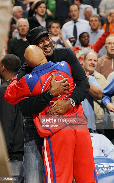 Michael Jordan hugs Fred Curly Neal of the Harlem Globetrotters at the Charlotte Bobcats game against the Miami Heat on March 9 2010 at the Time...
