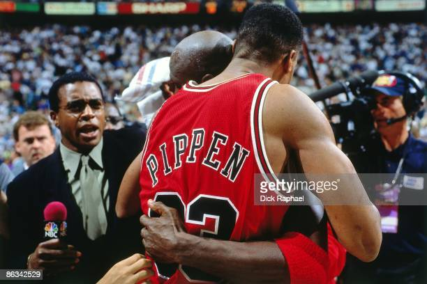 Michael Jordan hugs teammate Scottie Pippen of the Chicago Bulls following Game Five of the 1997 NBA Finals played against the Utah Jazz on June 11...