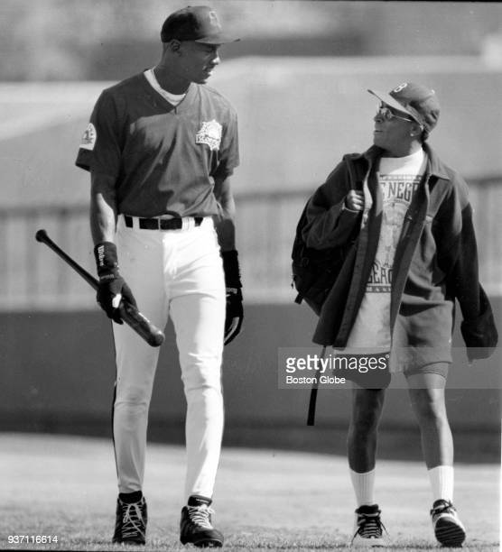 Michael Jordan, left, and movie director Spike Lee, right, speak at Scottsdale Stadium in Scottsdale, Az., Nov. 13, 1994. Jordan is playing baseball...