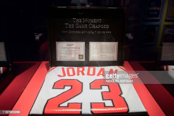 Michael Jordan limited edition jersey is displayed at the NBA exhibition in Beijing on August 19, 2019. - The Basketball world cup will be held from...