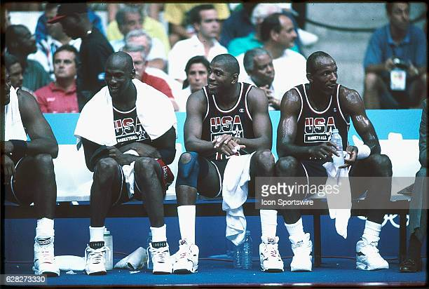 Michael Jordan , Magic Johnson and Clyde Drexler of Team USA, the Dream Team, sit on the bench during the men's basketball competition at the 1992...