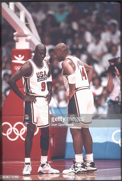 Michael Jordan of Team USA the Dream Team and teammate Charles Barkley talk oncourt during the men's basketball competition at the 1992 Summer...