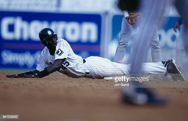 Michael Jordan of the Birmingham Barons dives into second during an August 1994 game against the Memphis Chicks at Hoover Metropolitan Stadium in...