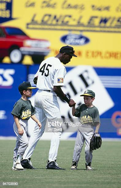 Michael Jordan of the Birmingham Barons meets with young fans before an August 1994 game against the Memphis Chicks at Hoover Metropolitan Stadium in...