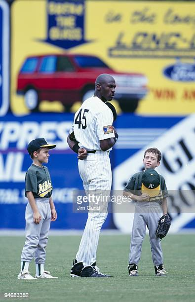 Michael Jordan of the Birmingham Barons stands for the National Anthem before an August 1994 game against the Memphis Chicks at Hoover Metropolitan...