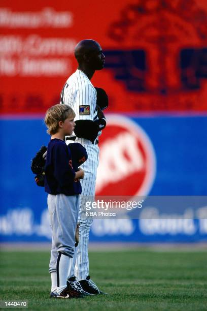 Michael Jordan of the Birmingham Barons stands with a Little League player during the National Anthem in Birmingham AL NOTE TO USER User expressly...